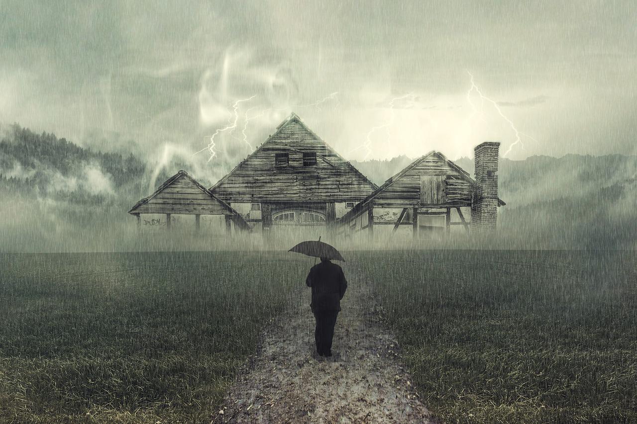 בית בגשם ואיש בשביל עם מטריה